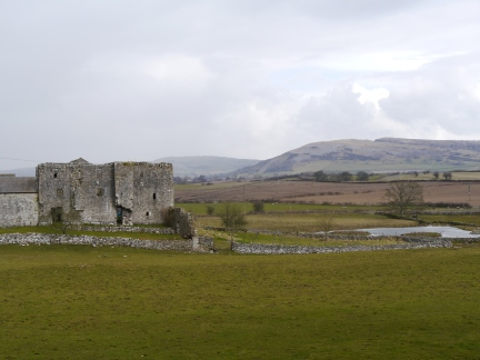 The ruins of Beetham Hall with Farleton Fell in the distance