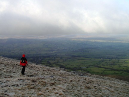 Lisa descending Pendle Hill