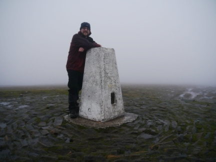 By the trig point on Pendle Hill