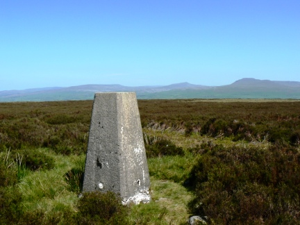The trig point on Burn Moor looking to Whernside and Ingleborough
