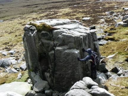 Matt trying to find a route to scramble up on to one of the larger outcrops on Wolfhole Crag