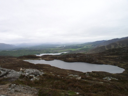 Lochan Dubh and the more distant Loch Alvie and Loch Insh
