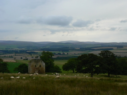 The remains of a bastle backed by the Cheviot hills
