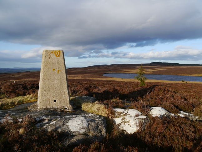 The trig point on Darden Pike looking to Darden Lough