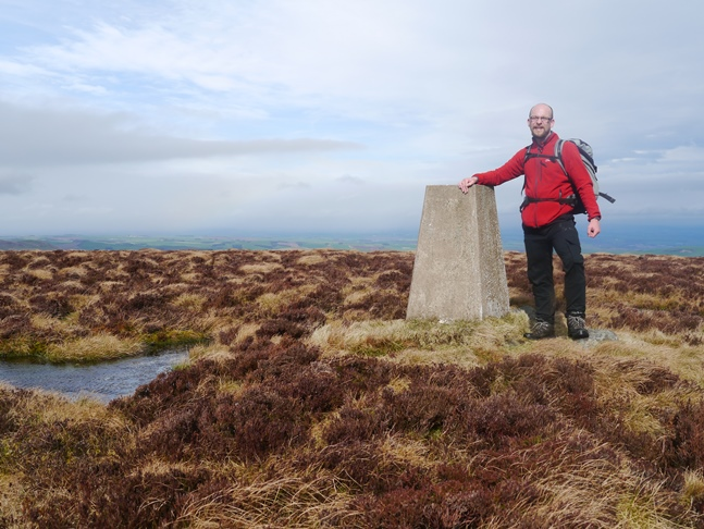By the trig point on the top of Newton Tors