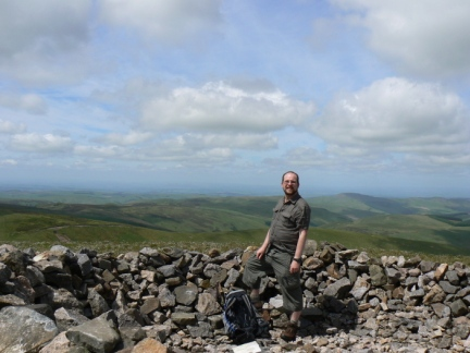 Standing in Russell's Cairn with Scotland behind me
