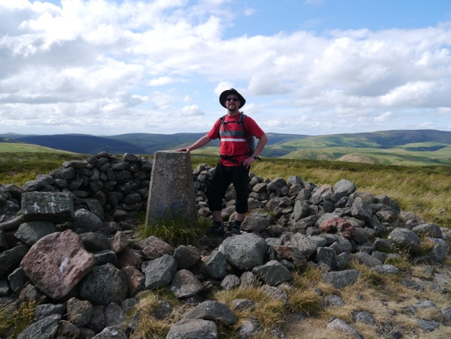 The shelter cairn and trig point on the summit of Shillhope Law