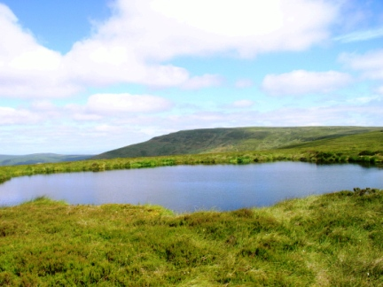 Peel Fell from the small tarn on Deadwater Moor