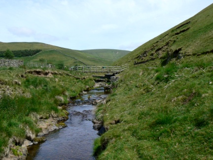 Looking along Rowhope Burn with Windy Gyle in the centre distance