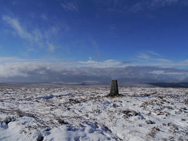 The trig point on the top of Carter Fell