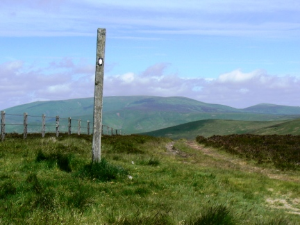 Pennine Way marker on the top of Mozie Law