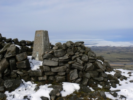 The trig point and summit cairn on Tosson Hill
