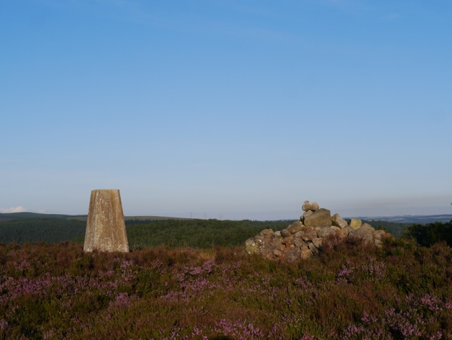 The trig point and neighbouring cairn