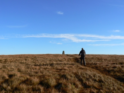 Matt approaching the trig point on the top of Gragareth