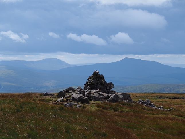 The large cairn on Archy Styrigg with Ingleborough and Whernside in the distance
