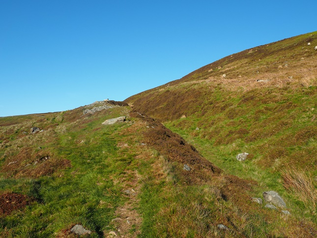 The raised path slanting up the fell below Old Pike which reminded me of a bank and ditch