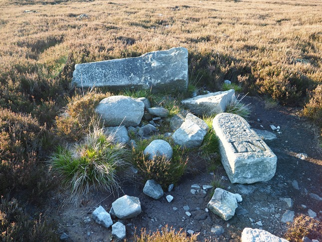 A shattered boundary stone to the east of the Grey Stone