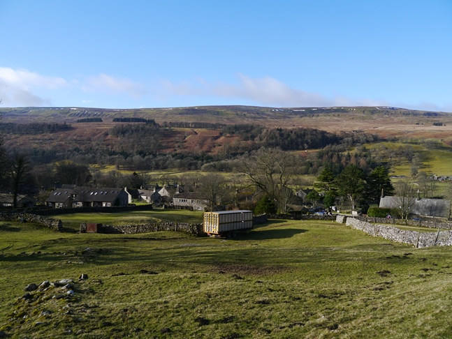 The village of Buckden with Birks Fell beyond