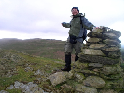 By the cairn on Eskholme Pike