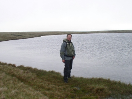 Standing by West Baugh Fell Tarn