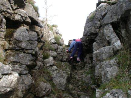 Amber scrambling out the head of Conistone Dib