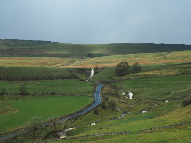 Looking down on Cray Gill with Park Lane heading up towards Kidstones