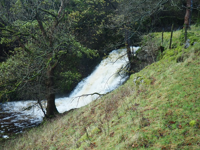 The waterfall in Cray Gill visible from the road just below the village