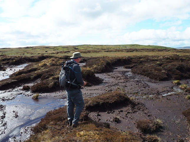 Stuart navigating the peat groughs of Fleet Moss