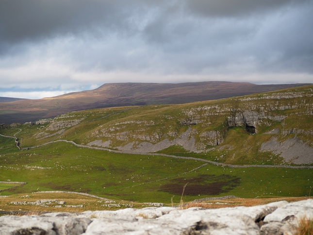 The view of Fountains Fell from Warrendale Knotts with Attermire Scar and the opening of Victoria Cave in the foreground