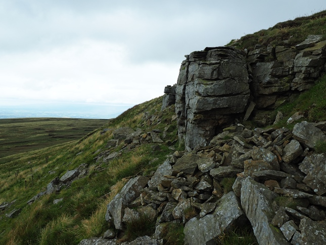 A modest outcrop of rock just below the summit of High Seat