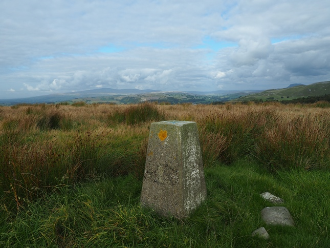 The trig point on Hunter Bark looking towards the Three Peaks