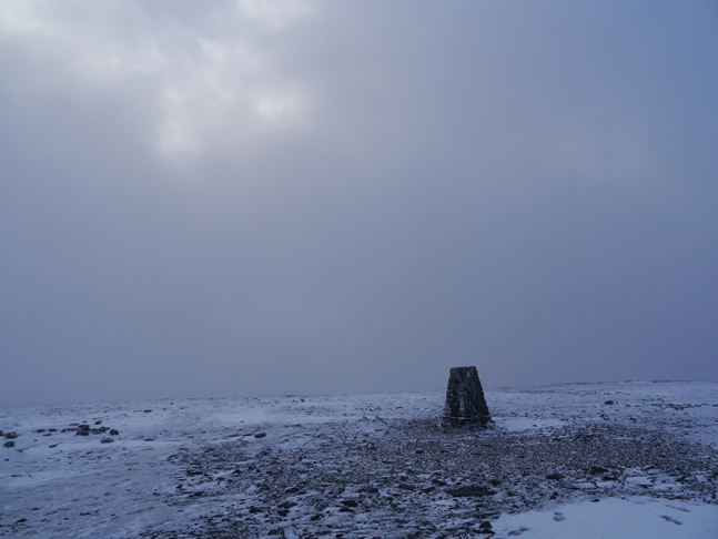The sun threatens to break out above the trig point on Ingleborough