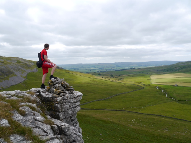 Jack enjoying the views of Crummackdale from Moughton Scars