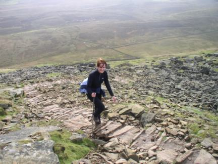 Lisa climbing the upper slopes of Pen-y-Ghent