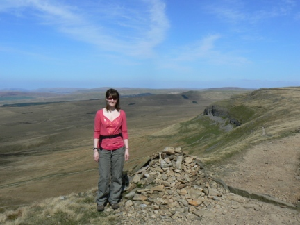 Lisa standing above Pen-y-Ghent side