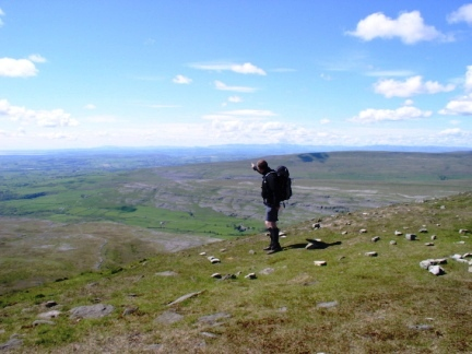 Matt on Ingleborough looking north-west to the Lake District