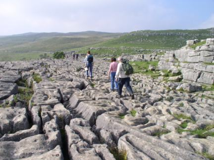 Traversing the limestone pavement above Malham Cove