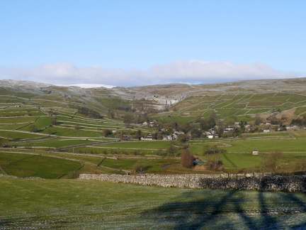 The view of Malham backed by the Cove from Windy Pike Lane