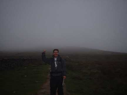 Matt standing in front of a cloud obscured Pen-y-Ghent