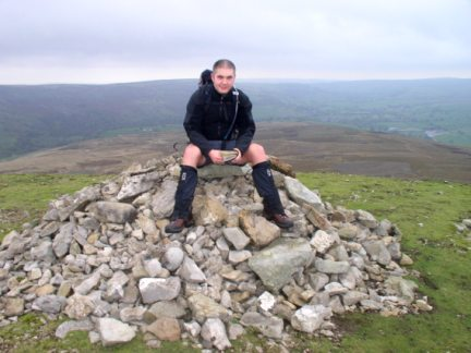 Matt on the summit cairn of Calver Hill