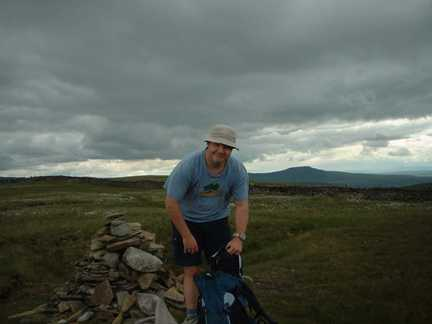 Matt by the summit cairn on Great Coum