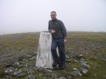 Matt by the trig point on Moughton