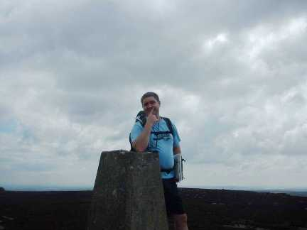 Matt by the trig point on Simon's Seat