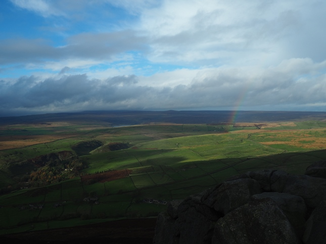 A brief patch of sunshine and a rainbow over Appletreewick Moor