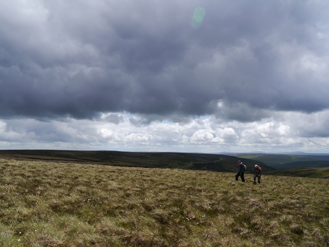 Ann and Ed crossing the moor heading for Water Crag