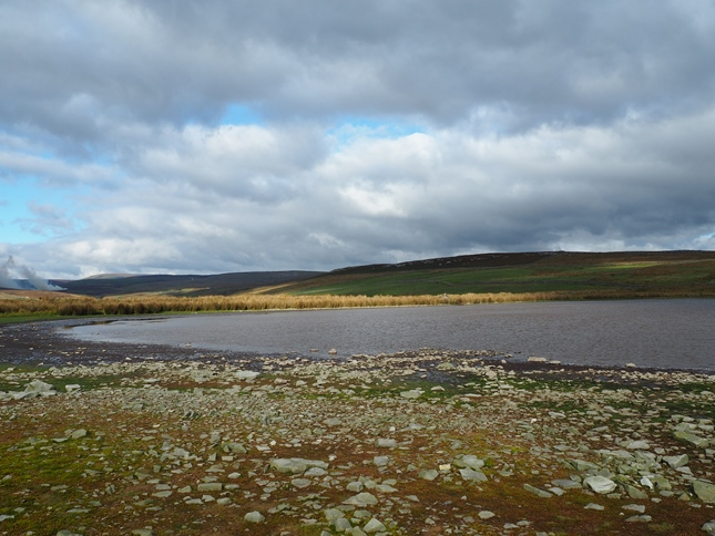 The stony shore of Mossy Moor Reservoir
