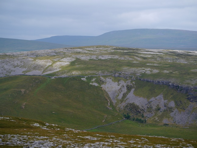 A zoom shot across Crummackdale to Moughton backed by Fountains Fell