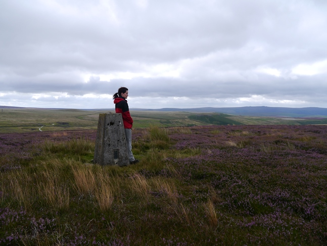 Lisa by the trig point on New Pasture Edge