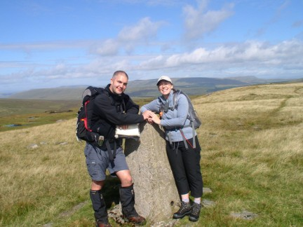 Matt and Jo by the trig point on Blea Moor