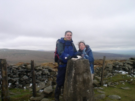 Matt and Jo by the trig point on Calf Top